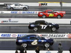 NHRA driver John Force, top, races against NASCAR drivers (from second from top) Greg Biffle, Matt Kenseth, and David Ragan during their drag racing exhibition.