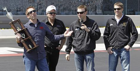 (From left to right) NASCAR driver Greg Biffle is congratulated by NHRA driver John Force and fellow NASCAR drivers Matt Kenseth and David Ragan after winning a four-wide drag racing exhibition Tuesday at ZMax Raceway.