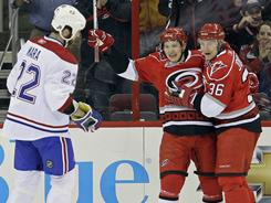 Hurricanes teammates Jeff Skinner, center, and Jussi Jokinen, celebrate Skinner's goal against the  Canadiens during the first period of their game Wednesday night.