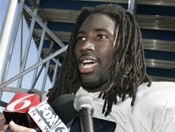 This 2005 file photo shows Auburn wide receiver Stanley McClover speaking with the media after a practice for the Capital One Bowl. Four former Auburn players have told HBO that they received thousands of dollars while being recruited by or playing for the Tigers.