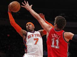 Carmelo Anthony, left, scored 39 points, grabbed 10 rebounds and dished out five assists in the Knicks' 120-116 win against the Nets on Wednesday.