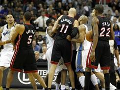 Washington's JaVale McGee (34) and John Wall (2) and Miami's Juwan Howard (5) and Zydrunas Ilgauskas (11) got into an altercation during the first half of Wednesday's game.