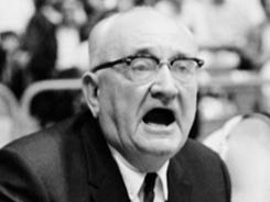 Adolph Rupp barks from the Kentucky bench during a game in 1968.