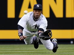 Curtis Granderson hit a go-ahead home run and made this diving catch to save a hit during the Yankee's opening-day win over the Tigers.