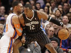 """Dwight Howard, backing down the Knicks' Jared Jeffries during a March 23 game, says """"Our focus should be on winning a championship and not where I'm going in two years."""""""