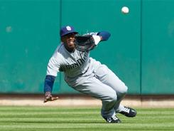 Cameron Maybin hit a game-tying two-run homer in the ninth inning and made this sliding catch to prevent a hit in the Padres' win over the Cardinals.