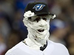 J.P. Arencibia sports the remnants of a shaving cream pie after hitting two home runs in the Blue Jays' season-opening win over the Twins.
