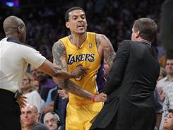 Matt Barnes, center, was ejected from the Lakers' win over the Mavericks Thursday night after an altercation with Jason Terry.