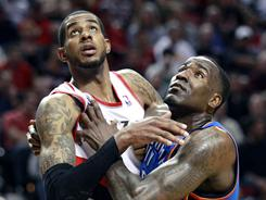 LaMarcus Aldridge, left, led the Blazers with 32 points in Portland's win. Kendrick Perkins, right, got in early foul trouble and played just 23 minutes.