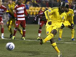 Andres Mendoza's (10) goal on a penalty kick helped Columbus shut out FC Dallas and earn their first win of the season.