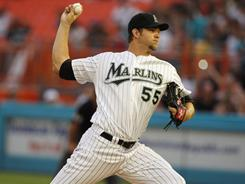 Josh Johnson took a no-hitter into the seventh inning before allowing two runs on three hits in the Marlins' season-opening win.