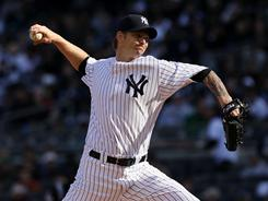 A.J. Burnett was solid in his 2011 debut, and the Yankees defeated the Tigers.
