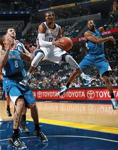 Memphis Grizzlies guard Mike Conley (11) passes under the basket...