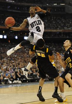 Butler guard Shawn Vanzant (2) leaps to the basket over VCU guard Brandon Rozzell during Butler's NCAA Tournament semifinal victory in Houston.