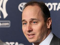 New York Yankees general manager Brian Cashman, seen here at a January press conference, confirmed he received a call on Saturday from the commissioner's office.