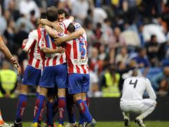 Sporting Gijon's players celebrate their upset 1-0 victory of Real Madrid in La Liga action on Saturday.