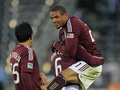 Caleb Folan and Anthony Wallace celebrate Folan's 81st-minute goal. The Rapids outclassed United 4-1.