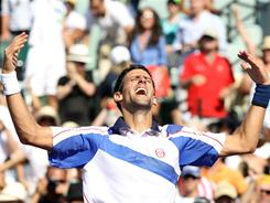 Novak Djokovic of Serbia celebrates Sunday after he defeated Rafael Nadal of Spain during the men's singles championship at the Sony Ericsson Open in Key Biscayne, Fla.
