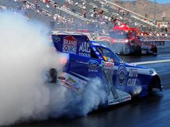NHRA funny car driver Robert Hight does a burnout during the Summitracing.com Nationals at The Strip in Las Vegas.