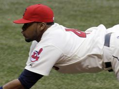 The Indians turn a triple play on the White Sox when first baseman Carlos Santana makes a diving grab on a bunt, then doubles the runners off first and second.
