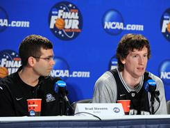 Butler coach Brad Stevens listens to player Matt Howard as he answers questions at the Final Four.