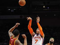 Carmelo Anthony (7) was one of three Knicks to score at least 23 points in New York's 123-107 win vs. the   Cavaliers on Sunday. The victory clinched New York's first playoff berth since 2004.