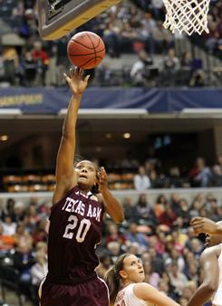 Tyra White goes up for two of her 18 points during Texas A&M's NCAA tournament semifinal victory against Stanford in Indianapolis. White made two layups in the game's final minute to help the Aggies pull off the upset.