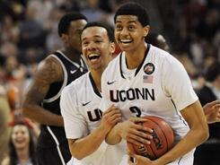 Connecticut swingman Jeremy Lamb (3) celebrates with guard Shabazz Napier after the title game victory Monday night.