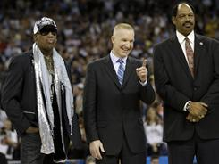 Basketball Hall of Famers form left to right, Dennis Rodman, Chris Mullin and Artis Gilmore are introduced at halftime of the men's NCAA championship game on Monday.