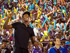Usain Bolt greets the adoring crowd at National Stadium in Kingston, Jamaica, last weekend during the boys' and girls' championships.
