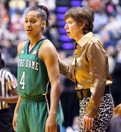Notre Dame head coach Muffet McGraw talks with sophomore point guard Skylar Diggins during their Final Four victory over UConn in Indianapolis.