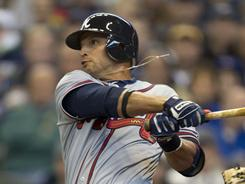 Braves' Martin Prado hits a home run in the eighth inning against the Brewers at Miller Park.