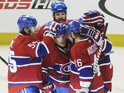 Montreal Canadiens' Michael Cammalleri celebrates with teammates after scoring against the Chicago Blackhawks during the second period of their game in Montreal on Tuesday night.
