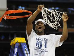 Kemba Walker celebrates with net cutting Connecticut's 53-41 victory against Butler in the NCAA men's basketball championship game.