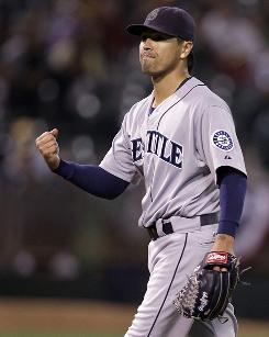 The Mariners' Brandon League, celebrating Saturday as the final out is made vs. the Athletics, is filling in for injured David Aardsma but has the skills to establish himself in the role.