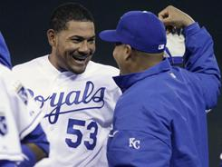 The Royals' Melky Cabrera (53) and Brayan Pena celebrate after Cabrera's game-winning RBI single in the 12th inning against the White Sox Tuesday. Kansas City beat Chicago 7-6.