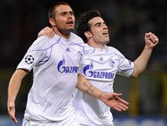 Schalke's striker Edu celebrates with teammate Jose Manuel Jurado after scoring against Inter Milan during their UEFA Champions League quarterfinal. Schalke defeated holders Inter 5-2 in a stunning result at the San Siro.