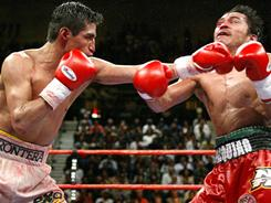 Erik Morales defeated Manny Pacquiao, right, in their first meeting, shown here in 2005. Pacquaio came back to win the next two by knockout.
