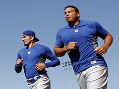 Cubs pitchers Carlos Zambrano, right, and Matt Garza continue to work on their temperaments.