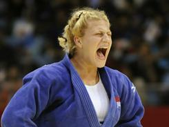 American Kayla Harrison reacts as she celebrates her win over Brazilian Mayra Aguiar during the women's -78kg class final match at the 2010 World Judo Championships in Tokyo on Sept. 9.