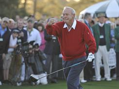 Four-time Masters Champion Arnold Palmer punctuates his ceremonial tee shot as the 75th Masters officially begins Thursday.