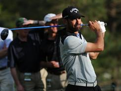 Alvaro Quiros, watching his tee shot on No. 15 during the first round of the 75th Masters, soared into a share of the lead.