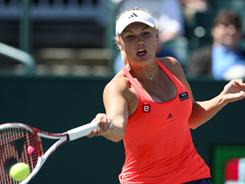 Caroline Wozniacki advanced to the quarterfinals of the Family Circle Cup after outlasting Barbora Zahlavova Strycova in two tiebreakers.
