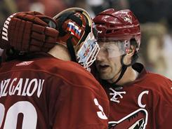 Shane Doan, right, and Ilya Bryzgalov celebrate the Coyotes' win over the Sharks that clinched a playoff spot.
