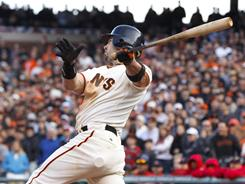 Aaron Rowand's game-winning single capped a back-and-forth 12-inning win for the Giants over the Cardinals.