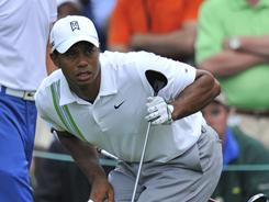 Tiger Woods keeps a close watch on his tee shot on 17 during the second round of the Masters on Friday. Woods shot a 66 and is three back.