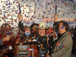 Roush Fenway Racing driver Matt Kenseth celebrates Saturday night after winning his second NASCAR Sprint Cup race at Texas Motor Speedway.