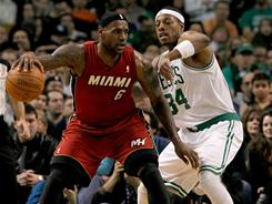 Paul Pierce (34) and the Celtics have gotten the better of LeBron James (6) and the Heat thus far this season, but Sunday's final meeting will decide the No. 2 in the Eastern Conference.
