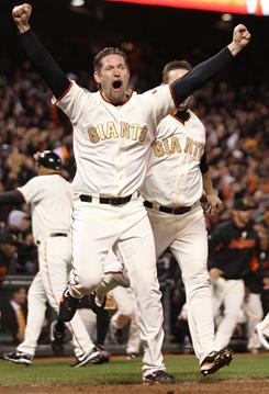 San Francisco's Aubrey Huff celebrates after Miguel Tejada drove home the game-winning RBI with two outs in the ninth inning against the Cardinals.