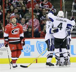 Carolina Hurricanes' Cory Stillman, left, reacts as Tampa Bay's Vincent Lecavalier (4), Brett Clark (7) and Teddy Purcell celebrate Clark's goal during their game in Raleigh. The Lightning won 6-2.
